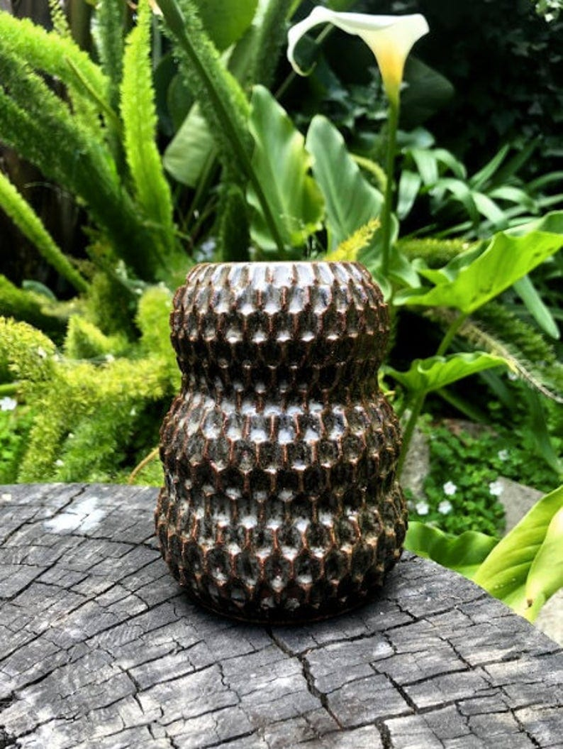 carved round vase
