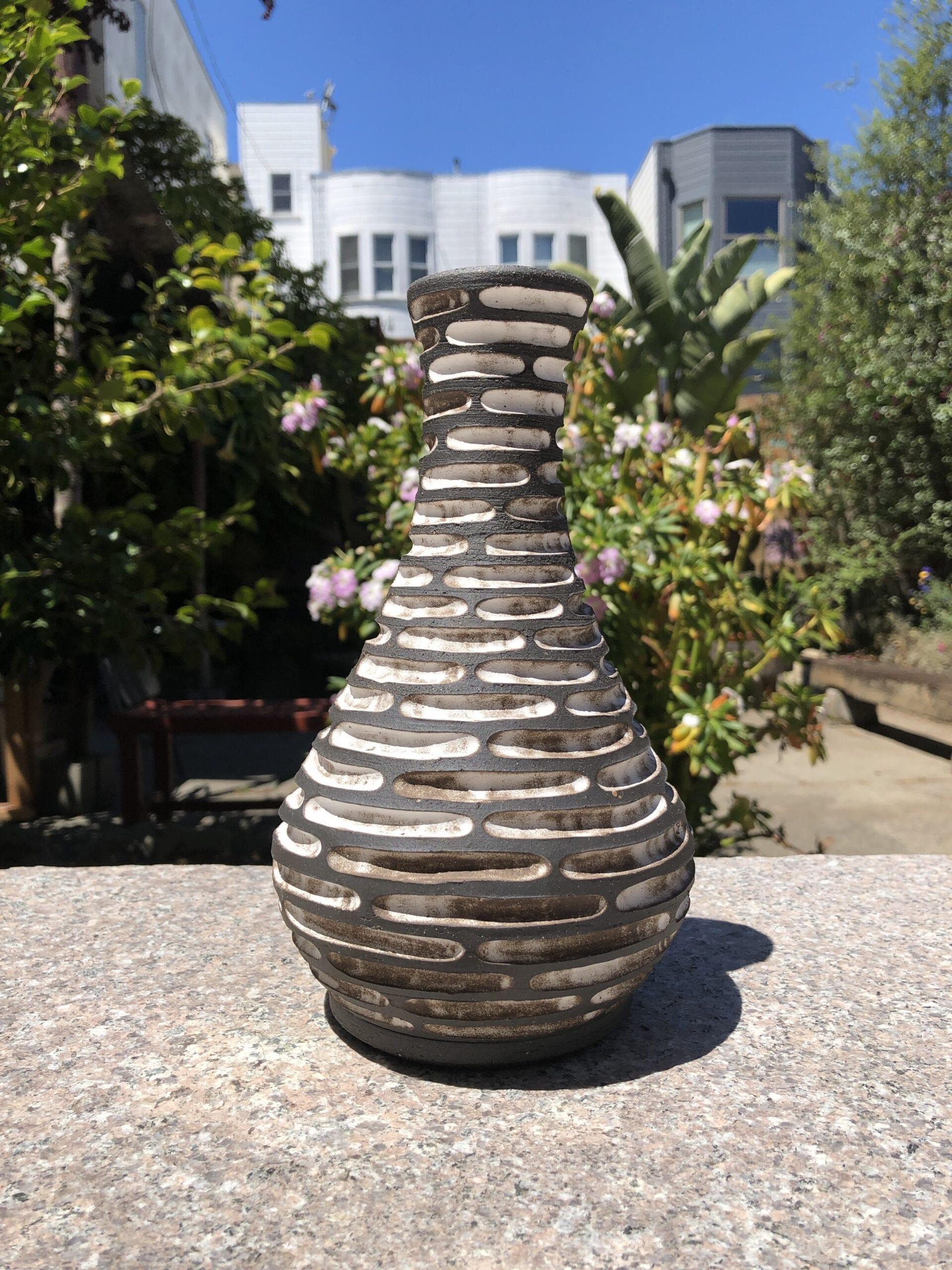 tall black white vase