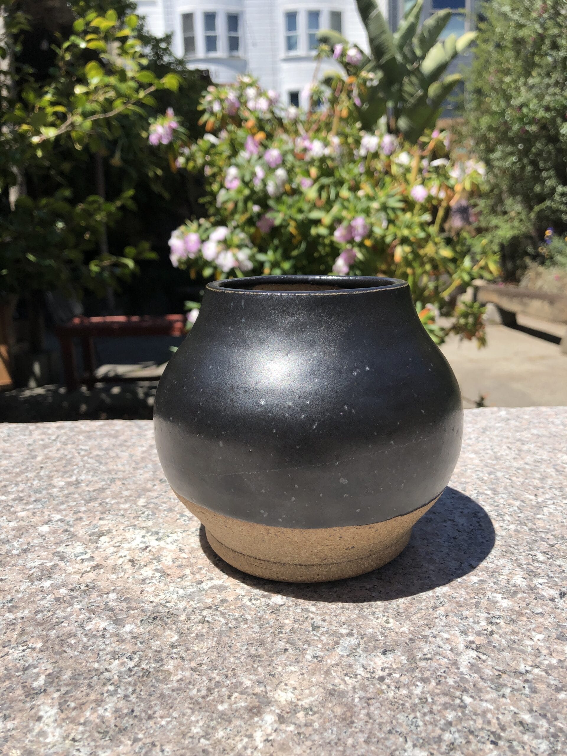 black stoneware jar