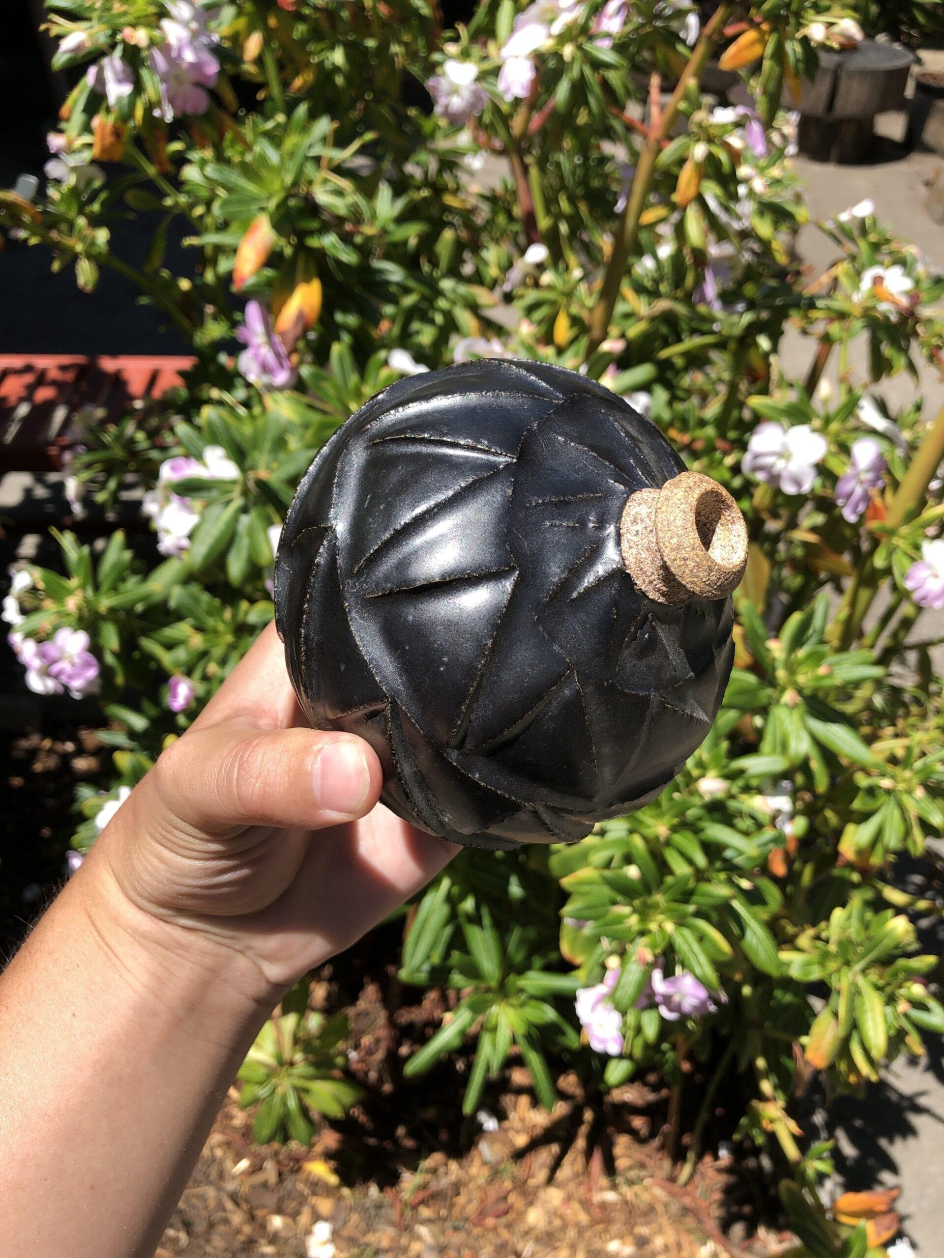 black carved bud vase