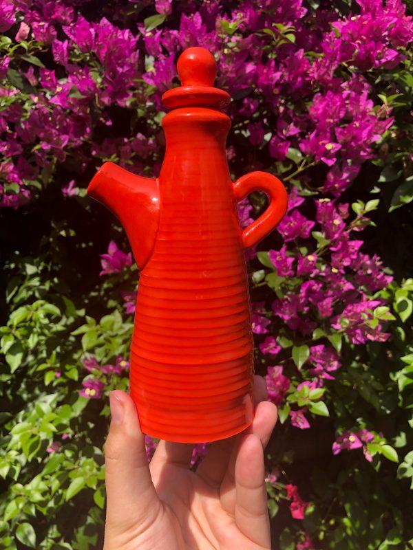 red orange teapot