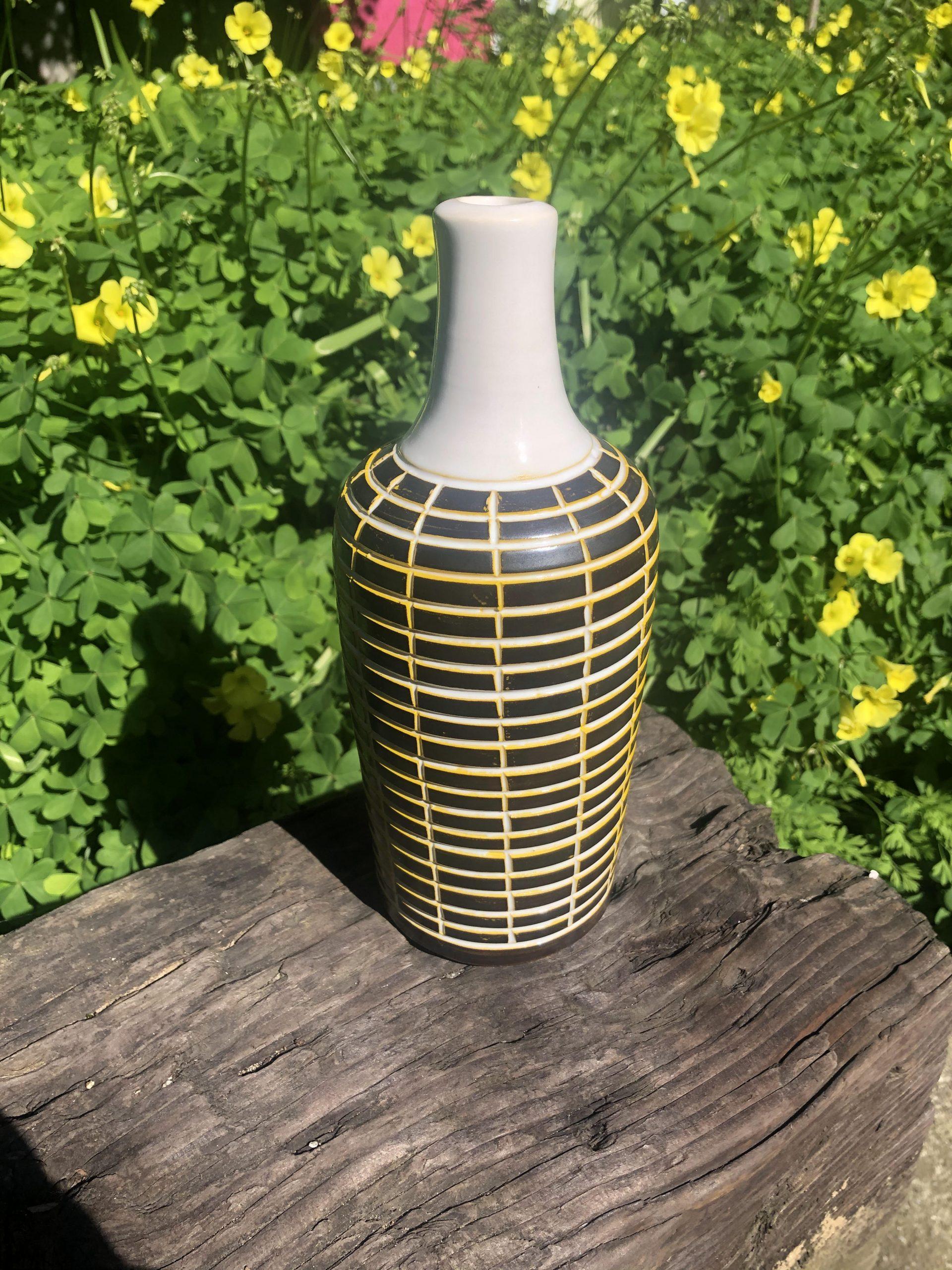black yellow vase
